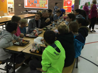 USDA Undersecretary Dr. Katie Wilson visits with Mrs. Fendrick's 6th grade class during lunch at Sanborn