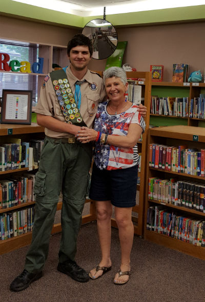 Matthew Rose with retired CTA Goodman principal, Maureen Sniff