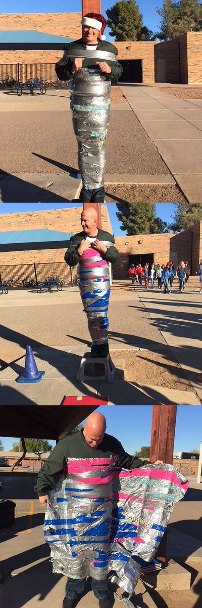 Principal Hickey taped to a pole