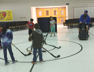 P.E.teacher Josh Waggoner riding the so-called Zamboni