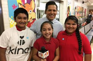 Students posing with Channel 3 reporter Javier