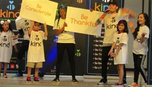 Students on stage with Be Kind Crew