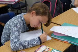 student working on a writing assignment
