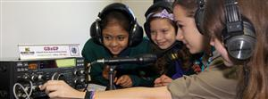These young ladies are at the GB2GP special event station for the Jamboree On The Air (JOTA) in the United Kingdom.