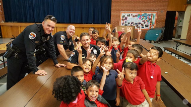 Three Chandler Police Officers having lunch with students