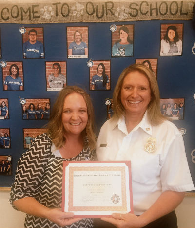 Heather Anguiano proudly accepting the Chandler Fire, Health, and Medicals' Partnership for L.I.F.E. 2016 Most Improved Award