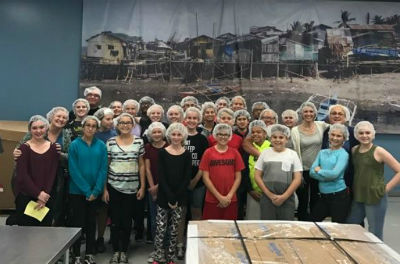 Payne Junior High staff and students volunteering at Feed My Starving Children
