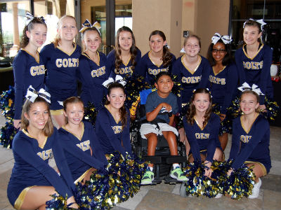 CCHS junior high cheer team with Nashua Robinson at the annual Nash Bash Golf Tournament at Seville