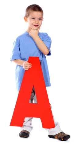 boy in blue shirt holding red letter A